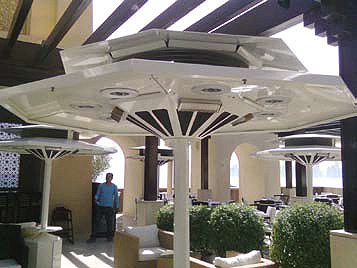 The outdoor dining area of the Pearl Hotel, Doha showing four of the seven, AerFresco CP7 units, each fitted with LED lighting, infrared heaters and programmable misting.
