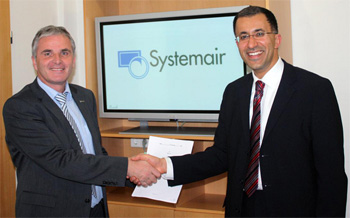 Kurt Maurer, Managing Director of Systemair and Dr Fathi Tarada, Managing Director of Mosen, after the signing the agreement in Boxberg-Windischbuch, Germany