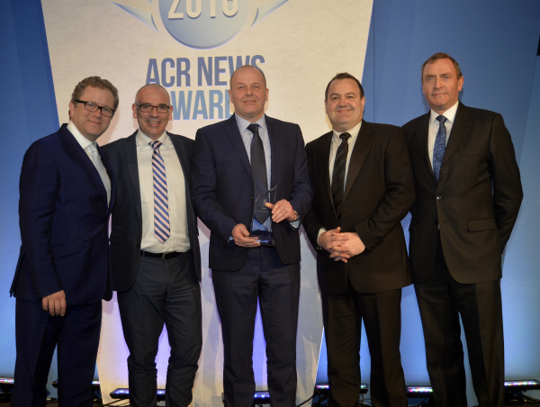 David Dunn (centre), Director and General Manager of Toshiba Air Conditioning, pictured receiving the award with the company's Neil Hitching and David Mansell, with celebrity host Jon Culshaw (left) and Russell Beattie, Chief Executive of FETA.