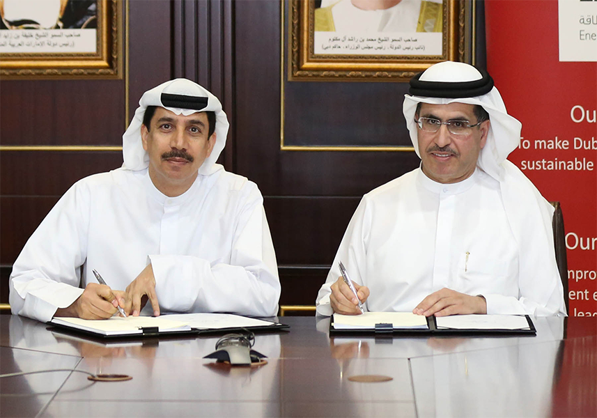H.E. Saeed Mohammed Al Tayer, Vice-Chairman of the Dubai Supreme Council of Energy (DSCE) and Chairman of Etihad Energy Service Company (ESCO), sign an Energy Performance Contract with H.E. Essa KazimGovernor of Dubai International Financial Centre (DIFC).