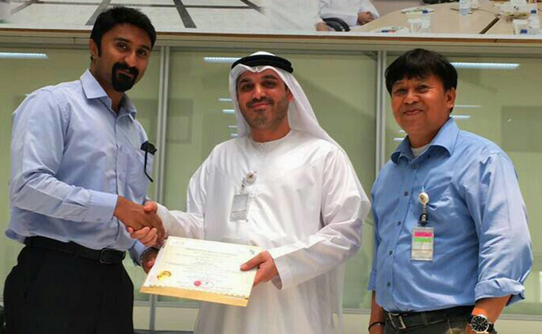 L-R: Umesh Unni from Hira Industries receives the DCL Certification from Arif Husain Al Marzooqi and Toreno Francisco of Dubai Municipality