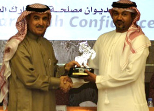 Husny Saeed, General Manager, Intertek receiving the Award
