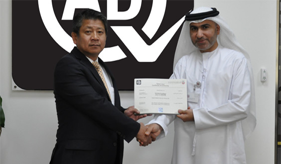 Ryoji Sano, President of Daikin Middle East and Africa receiving the certification
