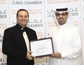 Adib Moubadder, CEO of Emicool, receiving the Dubai Chamber CSR Label certification from H.E. Hamad Buamim, Director General, Dubai Chamber