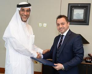 Mr. Abdulaziz Bin Yagub Al Serkal and Dr. Adnan Chilwan at the signing