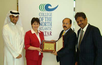 Award for The College of The North Atlantic. From left to right: Khaled Mohsen, Monica Kennedy, Ramiz Gabrial and Seenu Pillai