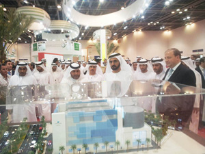 H.H. Sheikh Mohammed bin Rashid Al Maktoum, Prime Minister and Vice President of the UAE and Ruler of Dubai, examines the plans of Empower's new district cooling plan in Business Bay during his tour at WETEX